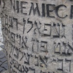 Warsaw: Hebrew on the memorial piece to mark a house in the upraising in Warsaw