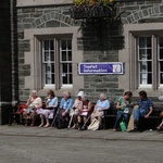 Tavistock oldies enjoying the sun as a wedding entourage forms