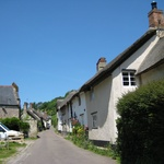 Many thatched cottages all in a row