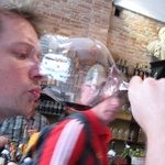 Tasting the wine from the biggest glass ever.