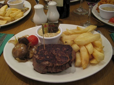 Well worth the wait - a massive Angus Fillet steak with large chips and a haggis sauce.