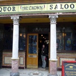 Oldest & prettiest Saloon bar with Italian tiles, metal roof & wooden booths with doors!