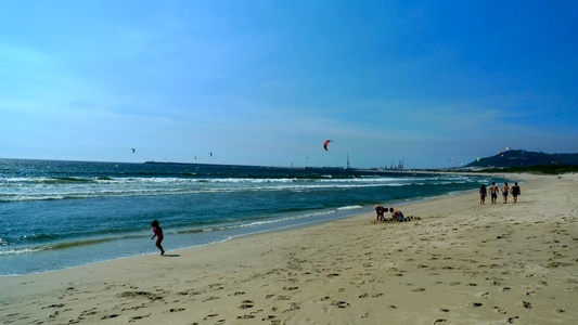 The sky was littered with kite surfers.