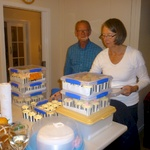 Uncle Peter looks on as Trish packages up the 100+ cupcakes