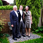 A happy groom with Mum and Dad