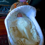 Asleep for the first time in her bassinet.