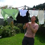 Dad hangs out the washing. So many small bits and pieces.